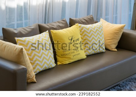 modern living room design with brown sofa and yellow pillows - stock photo