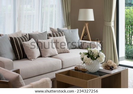 modern living room design with sofa and wooden lamp - stock photo