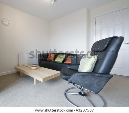 modern living room detail with black leather sofa and armchair - stock photo