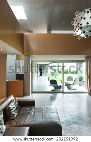 Modern living room, interior, house in cement - stock photo