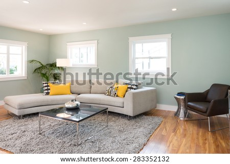 Modern living room interior in mid century home with couch and yellow pillows. - stock photo