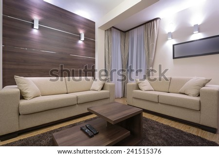Modern living room interior in the evening - stock photo