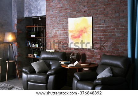 Modern living room interior with leather armchairs - stock photo