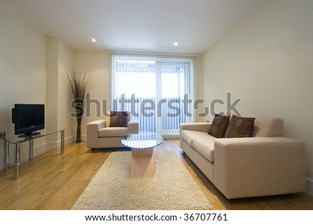 modern living room with beige sofas