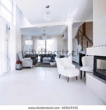 Modern living room with big garden windows - stock photo