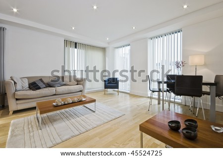 modern living room with cozy furniture and floor to ceiling windows - stock photo