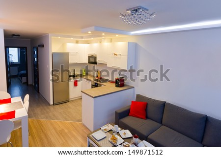 Modern living room with kitchen interior - stock photo