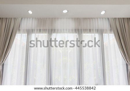 Modern living room with soft white and grey curtain background - stock photo