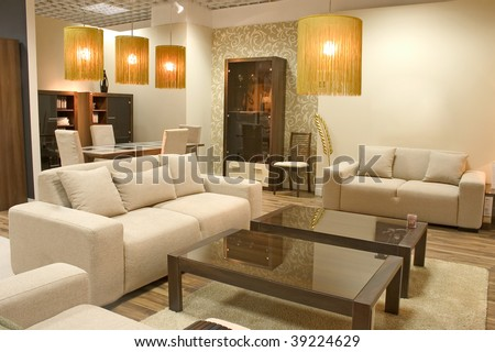 Modern living room with warm colors. Two big sofas and a caffee table. - stock photo