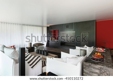 Modern living room with white divans, curtains on the windows - stock photo