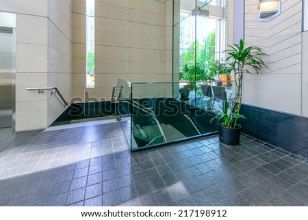 Modern lobby with the escalator, hallway of the luxury hotel, shopping mall, business center in Vancouver, Canada. Interior design. - stock photo