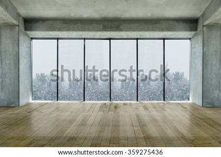 Modern lofty interior with large windows with snow and tree view - stock photo