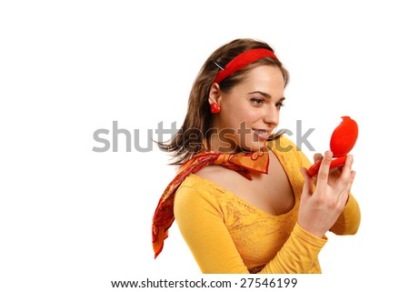 Modern looking young woman looking in the mirror - stock photo