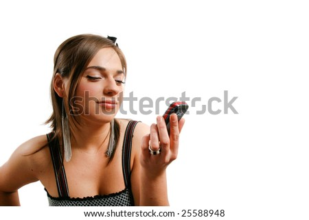 Modern looking young woman watching her phone. - stock photo