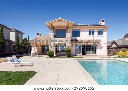 Modern luxurious house with deckchairs and endless pool. - stock photo