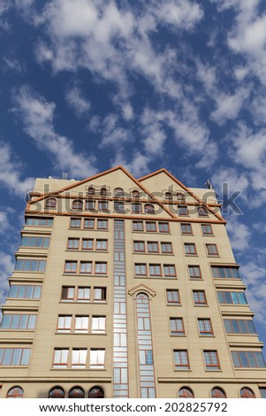 Modern luxury apartment against cloudy blue sky with empty space at the top for your text - stock photo