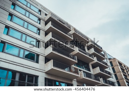 Modern luxury apartment condominiums with concrete exterior walls and large glass windows in Germany