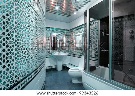 Modern luxury bathroom blue interior - stock photo
