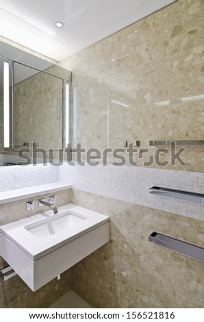 modern luxury bathroom with built in mirror lights and towel rails - stock photo