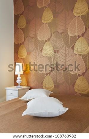 Modern luxury bedroom with wallpaper /  Hotel Room - stock photo