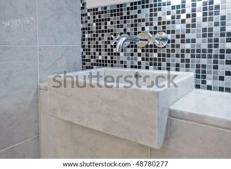 modern luxury hand wash basin made of marble - stock photo