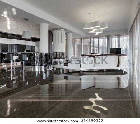 Modern luxury interior in minimalistic style: new living room and kitchen in daylight - stock photo