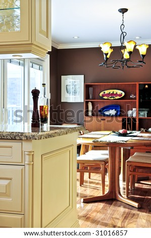 Modern luxury kitchen and dining room interior - stock photo