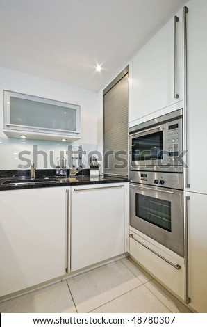 modern luxury kitchen counter with built in electric appliances - stock photo