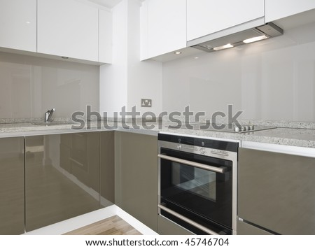 modern luxury kitchen with glossy surface finish