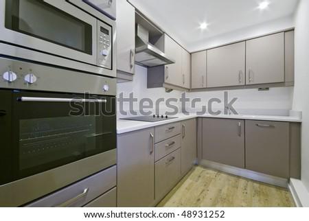modern luxury kitchen with hard wood floor - stock photo