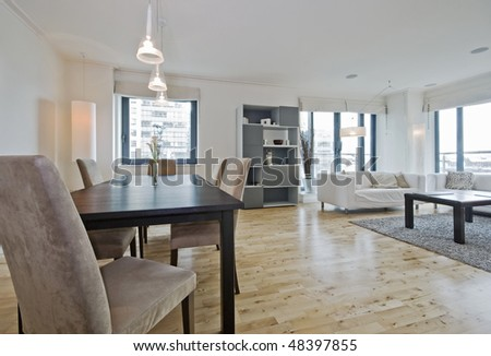 modern luxury living room with massive hard wood dining table - stock photo