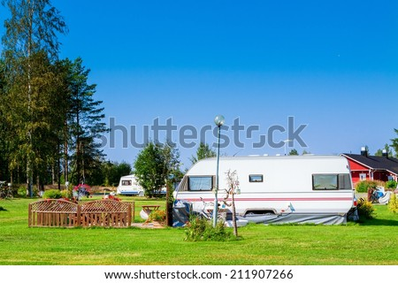 Modern luxury mobile homes in a caravan park. - stock photo
