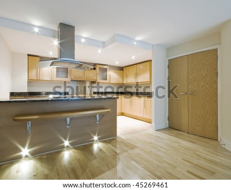 modern luxury open plan kitchen with breakfast bar - stock photo