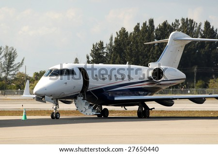 Modern luxury private jet welcoming passengers - stock photo