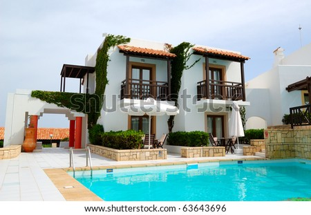 Modern luxury villa with swimming pool at luxury hotel, Crete, Greece - stock photo