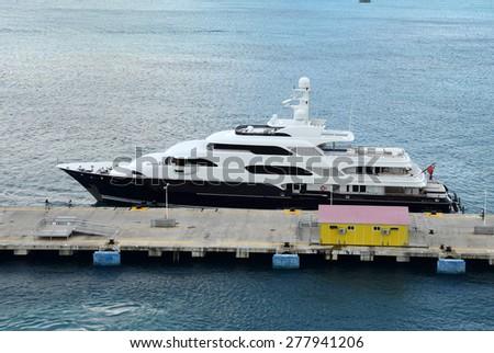 Modern luxury yacht docking in Saint Martin Caribbean - stock photo