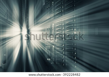 modern mainframe disk storage in the data center motion blur tone - stock photo