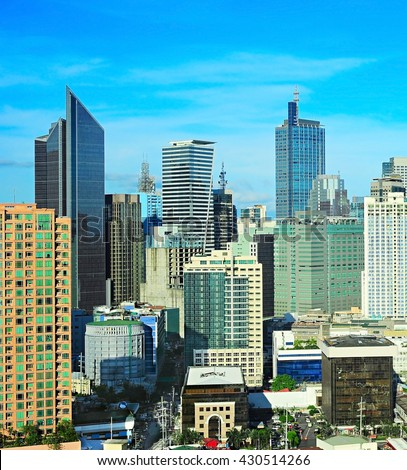 Modern Makati city - financial and business district of Metro Manila, Philippines - stock photo