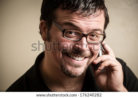 Modern man talking on a cell phone - stock photo