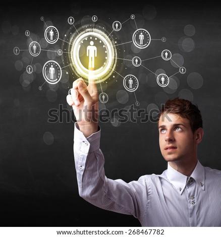 Modern man touching future technology social network button  - stock photo