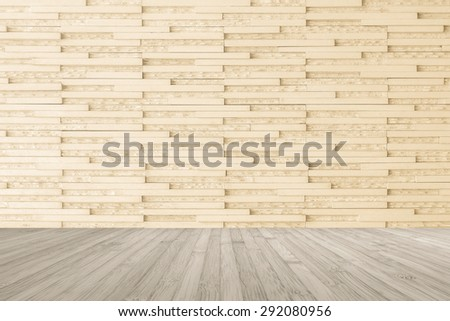 Modern marble tile wall pattern  background in light cream beige color with wooden floor in sepia grey tone : Horizontal marble rock stone tiled pattern texture backdrop with wood flooring           - stock photo