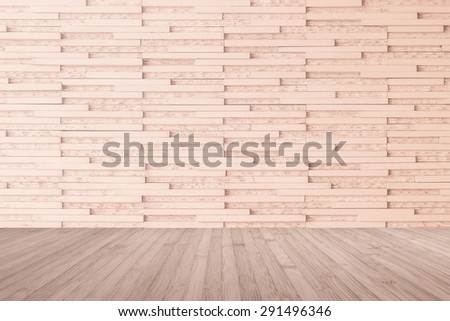 Modern marble tile wall pattern  background in light red brown color with wooden floor in red brown tone : Horizontal marble rock stone tiled pattern texture detailed backdrop with wood flooring  - stock photo