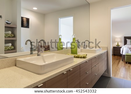 Modern master bathroom with above counter sink.
