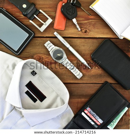 Modern men's clothing and accessories on wooden grungy background - stock photo