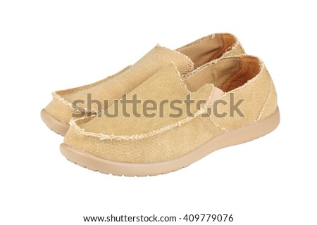 Modern men's loafers over white background  - stock photo