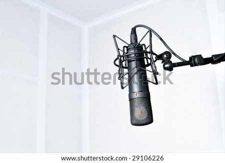 Modern microphone in the radio room - stock photo