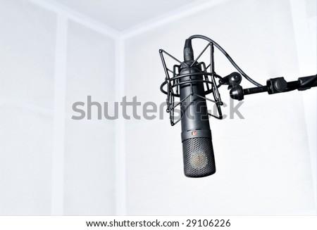Modern microphone in the radio room - stock photo
