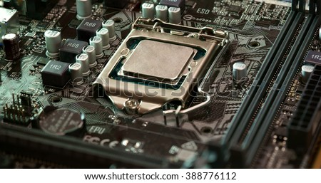 modern microprocessor. Technician plug in CPU microprocessor to motherboard socket. Workshop background - stock photo