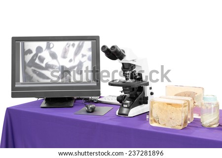 modern microscope with liver fluke - stock photo