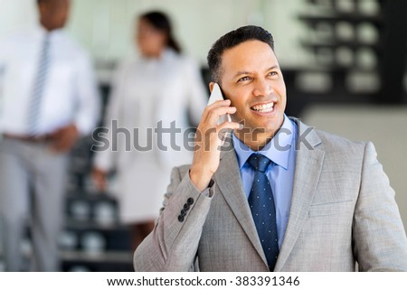modern mid age business executive talking on cell phone - stock photo